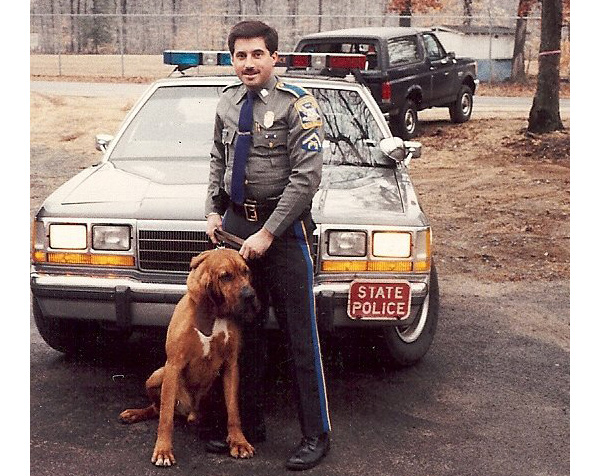 Connecticut police car and officer with dog image
