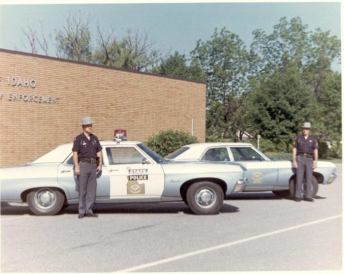 Idaho state police car and officers