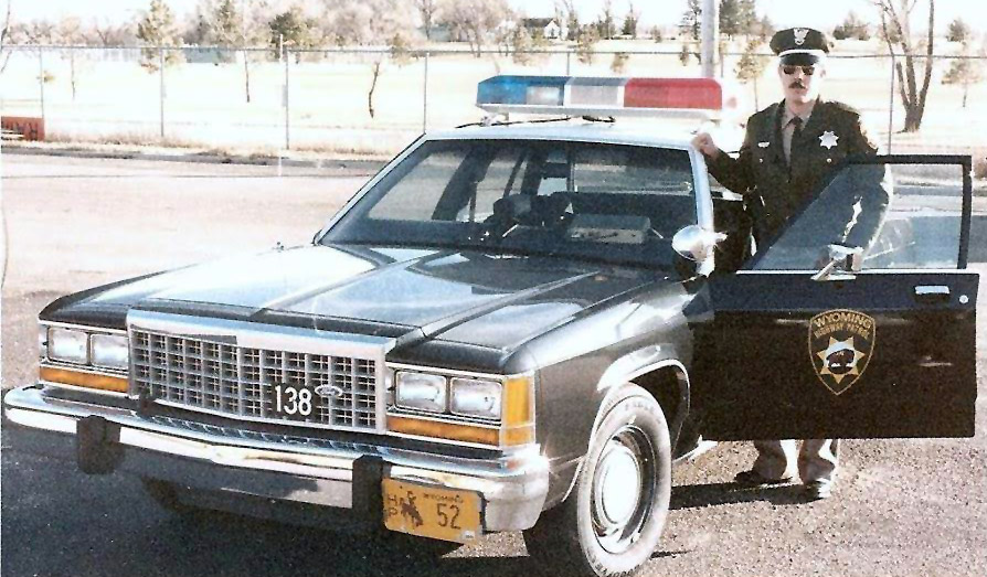 Wyoming police officer and car